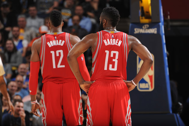 Dwight Howard #12 and James Harden #13 of the Houston Rockets while facing the Golden State Warriors.