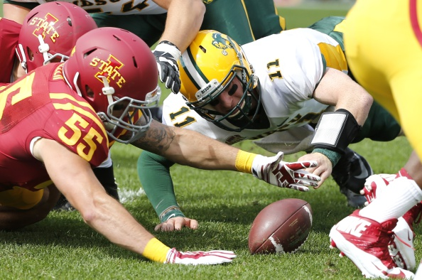 AMES, IA - AUGUST 30: Quarterback Carson Wentz #11 of the North Dakota State Bison fights to recover a fumble with linebacker Jevohn Miller #55 of the Iowa State Cyclones in the first half of play at Jack Trice Stadium on August 30, 2014 in Ames, Iowa. The Bisons recovered the ball on the play. (Photo by David Purdy/Getty Images)