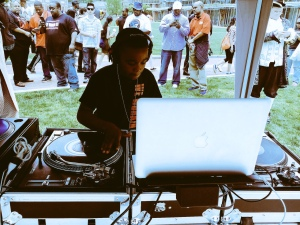 11-year-old DJ on the turn tables. (Credit: Cherri Gregg)