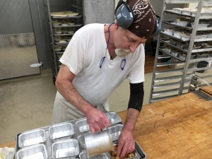 A baker at Denise's hard at work. (credit: Cherri Gregg)