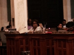 Blondell Reynolds Brown listens as councilman Bobby Henon questions her container tax bill. (Credit: Pat Loeb)
