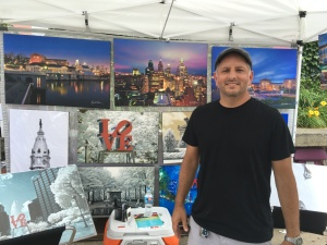 Russell Brown showcasing some of his art work. Photo credit: KYW's Andrew Kramer