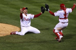 PHILADELPHIA - OCTOBER 29: Brad Lidge #54 (L) and Carlos Ruiz #51 of the Philadelphia Phillies celebrate the final out of their 4-3 win to win the World Series against the Tampa Bay Rays during the continuation of game five of the 2008 MLB World Series on October 29, 2008 at Citizens Bank Park in Philadelphia, Pennsylvania. (Photo by Jim McIsaac/Getty Images)