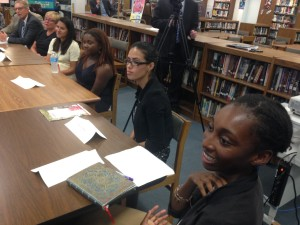 Natalie Jimenez (center) and Christina Cover (right) at the round table. (Credit: David Madden)