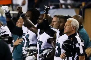CHICAGO, IL - SEPTEMBER 19: Philadelphia Eagles players hold up a salute during the national anthem prior to the game against the Chicago Bears at Soldier Field on September 19, 2016 in Chicago, Illinois. (Photo by Jonathan Daniel/Getty Images)