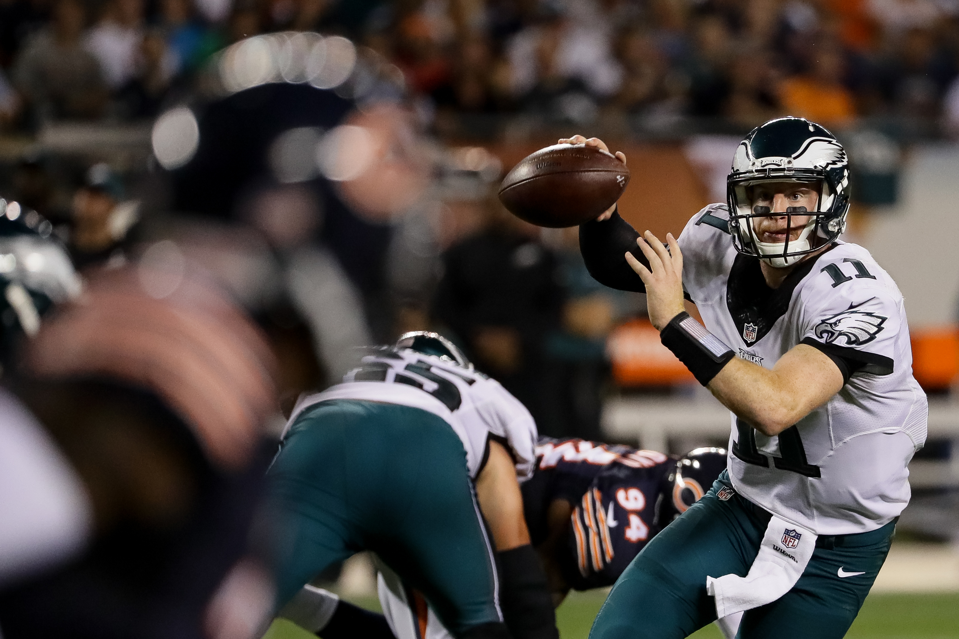 CHICAGO, IL - SEPTEMBER 19:  Quarterback Carson Wentz #11 of the Philadelphia Eagles looks to pass the football in the first half against the Chicago Bears at Soldier Field on September 19, 2016 in Chicago, Illinois.  (Photo by Jonathan Daniel/Getty Images)