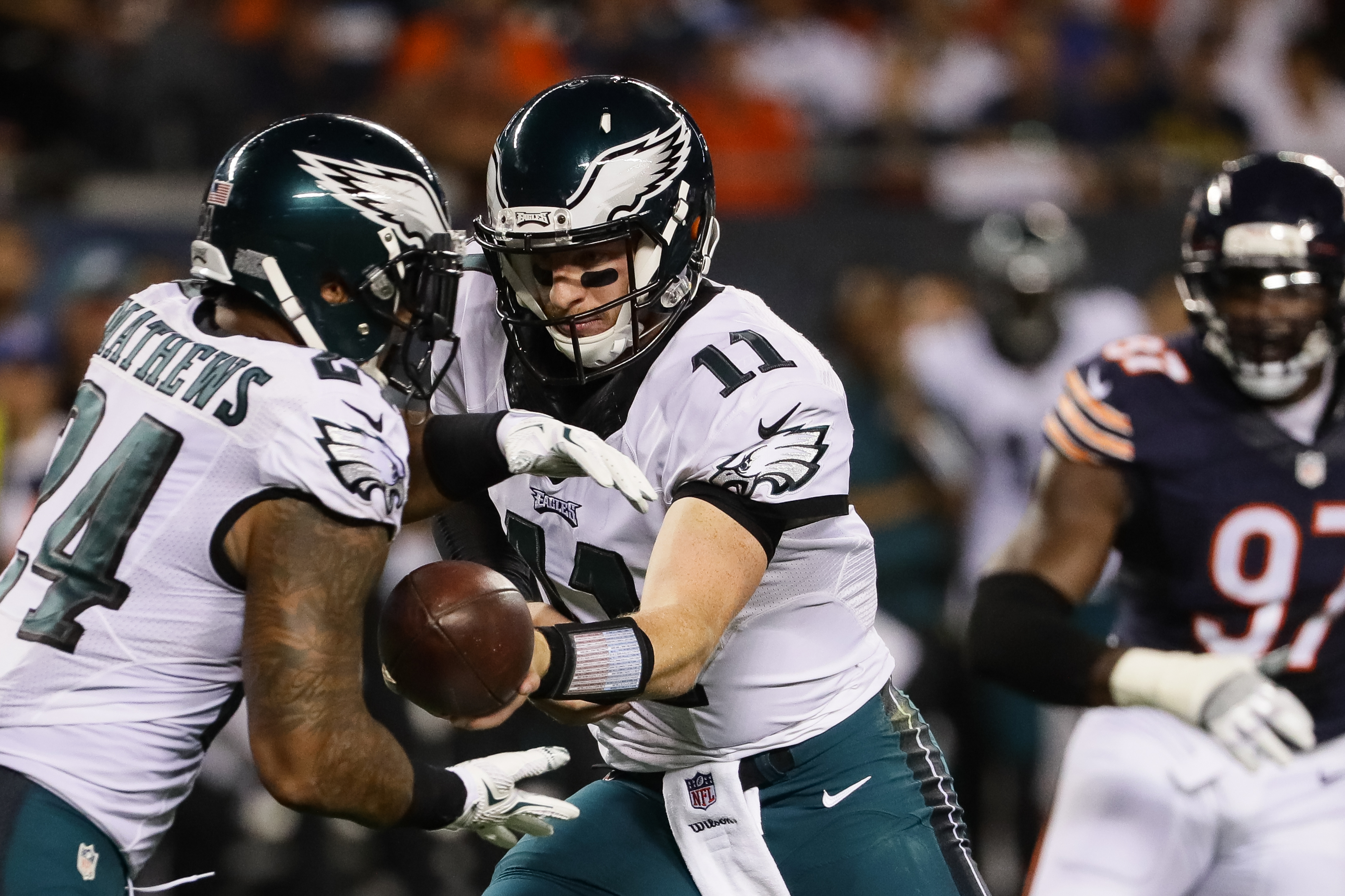 CHICAGO, IL - SEPTEMBER 19:  Quarterback Carson Wentz #11 of the Philadelphia Eagles hands off the football to Ryan Mathews #24 in the first half against the Chicago Bears at Soldier Field on September 19, 2016 in Chicago, Illinois.  (Photo by Jonathan Daniel/Getty Images)