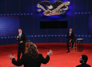 HEMPSTEAD, NY - OCTOBER 16:  Moderator Candy Crowley of CNN tries to bring Republican presidential candidate Mitt Romney (L) and U.S. President Barack Obama back on topic during a town hall style debate at Hofstra University October 16, 2012 in Hempstead, New York. During the second of three presidential debates, the candidates fielded questions from audience members on a wide variety of issues. (Photo by Spencer Platt/Getty Images)
