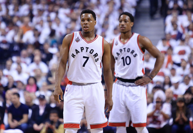 Kyle Lowry #7 and DeMar DeRozan #10 of the Toronto Raptors look on in the first half of Game Seven of the Eastern Conference Quarterfinals against the Miami Heat during the 2016 NBA Playoffs at the Air Canada Centre on May 15, 2016 in Toronto, Ontario, Canada.