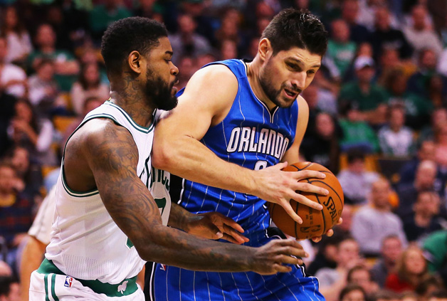 Nikola Vucevic #9 of the Orlando Magic drives against Amir Johnson #90 of the Boston Celtics during the second quarter at TD Garden on January 29, 2016 in Boston, Massachusetts.