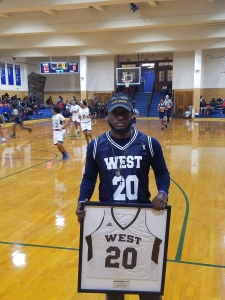 Akyra's brother, Alex holding his late sister's jersey (credit: Justin Udo)