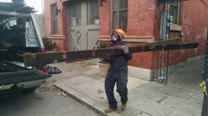 Aineias Clanton, YouthBuild graduate and Philadelphia Community Corps job trainee hauls Douglas fir decking from the worksite in Fairmout. (Credit: Tom Rickert)