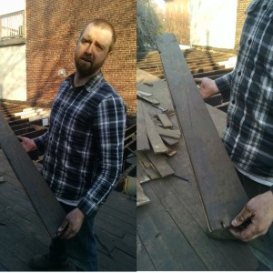 Greg Trainor of the Philadelphia Community Corps holding a piece of salvaged decking. (Credit: Tom Rickert)