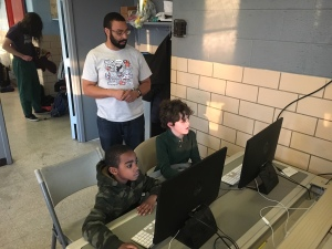 Sylvester Mobley working with a couple of kids at Marian Anderson Rec Center (credit: Cherri Gregg)