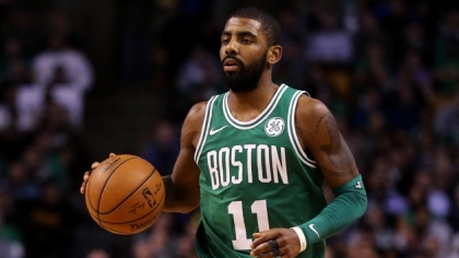 Kyrie Irving #11 of the Boston Celtics dribbles against the Golden State Warriors during the fourth quarter at TD Garden on November 16, 2017 in Boston, Massachusetts. The Celtics defeat the Warriors 92-88.