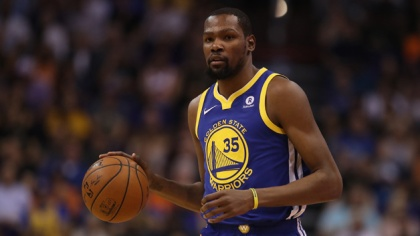Kevin Durant #35 of the Golden State Warriors handles the ball during the first half of the NBA game against the Phoenix Suns at Talking Stick Resort Arena on April 8, 2018 in Phoenix, Arizona.