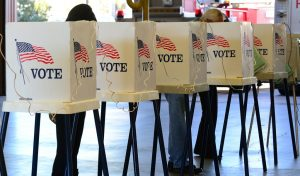 File photo of voting booths. (Photo by FREDERIC J. BROWN/AFP/Getty Images)