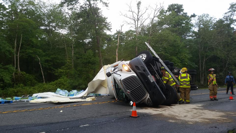 Overturned Tractor-Trailer Spills Water Bottles On Route 206