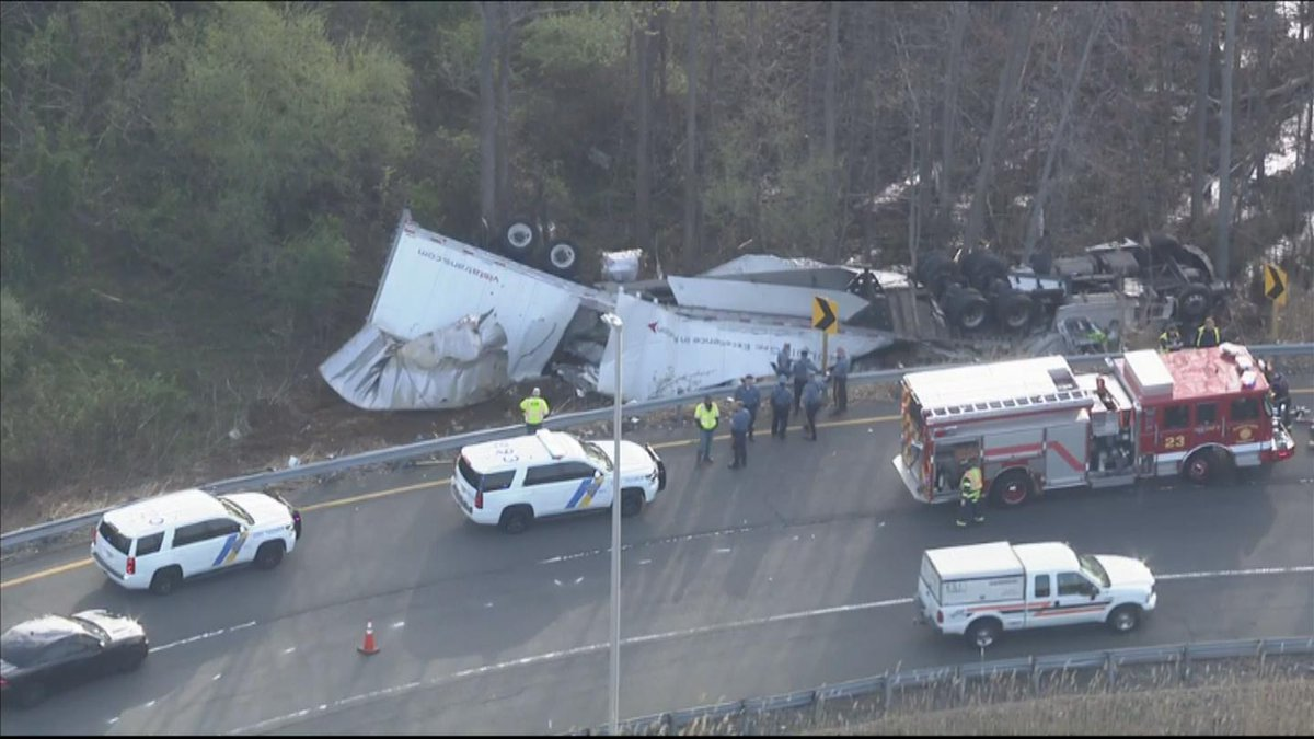 Driver Dies After Tractor-Trailer Overturns Into Embankment