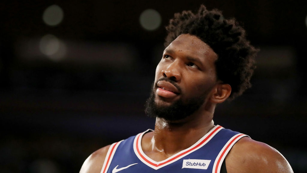 Joel Embiid #21 of the Philadelphia 76ers looks on in the second half against the New York Knicks at Madison Square Garden on February 13, 2019 in New York City