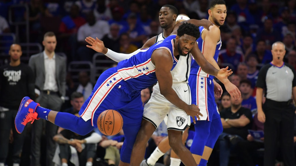 Joel Embiid #21 of the Philadelphia 76ers loses the ball as Caris LeVert #22 of the Brooklyn Nets defends in the first half during Game One of the first round of the 2019 NBA Playoff at Wells Fargo Center on April 13, 2019 in Philadelphia, Pennsylvania.