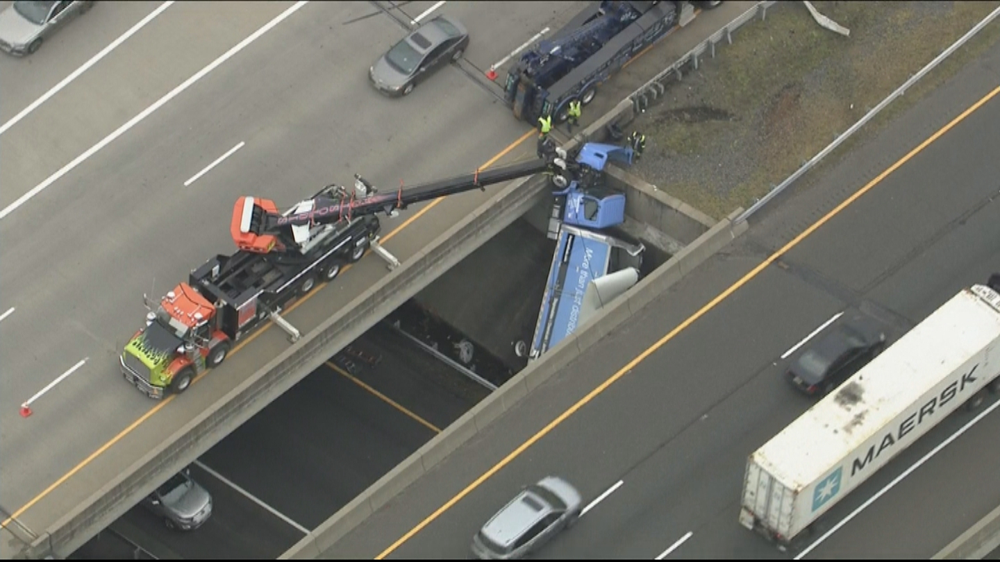 Crane Removing Truck Dangling Off Overpass After Accident On I-195