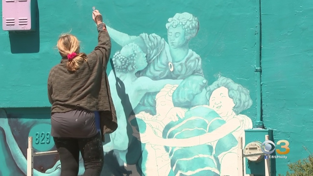 Coronavirus Philadelphia: Award-Winning Muralist Bringing Safe Hugs To City During Pandemic