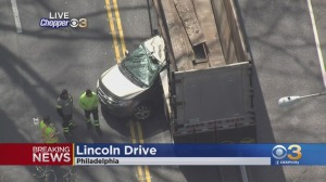 Car Becomes Wedged Under Tractor-Trailer Along Lincoln Drive