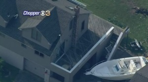 Roofs Torn Off Buildings, Small Boat Found Between Houses Following Storm In Long Beach Island, New Jersey