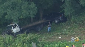 Car Carrier Goes Down Embankment Following Crash In Doylestown